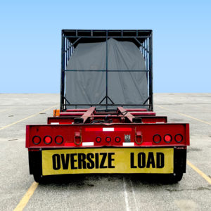 Rear view of truck chassis for oversize freight.